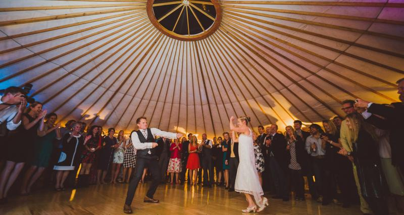 Dancing on wooden dance floor in yurt