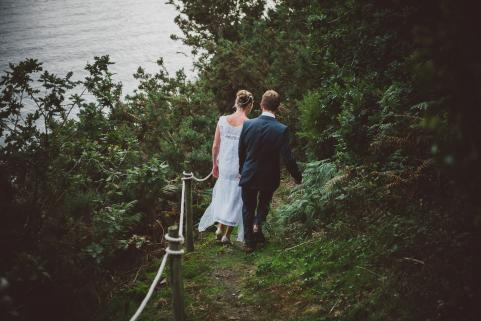 Newly weds walk down to river