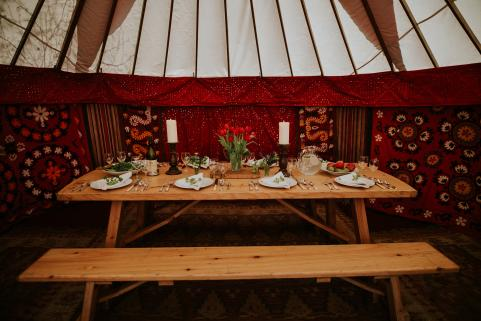 18ft yurt with stunning decor and 8ft banqueting table