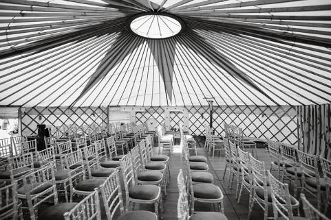 32ft yurt with simple decor and wedding seating