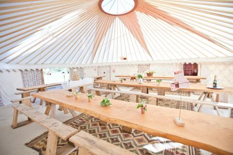 32ft yurt with stunning decor and rustic tables