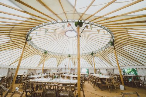 44ft yurt with stunning decor and rustic tables