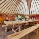 One of our super hand crafted tables from the amazing team @barreltopwagons looking lovely in a 24ft yurt.  #yurts #woodenfurniture #weddingfurniture
